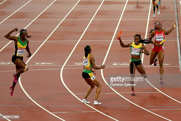 Novlene WilliamsMills of Jamaica crosses the line to win gold ahead of Francena McCorory of the United States in the Women's 4x400 Relay Final during...