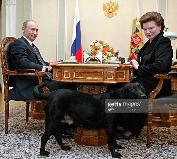 Russian President Vladimir Putin and Valentina Tereshkova the first womancosmonaut in space smile as they look at Putin's family dog Koni during...