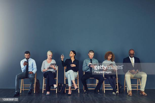 now comes the wait - people in a row stock pictures, royalty-free photos & images