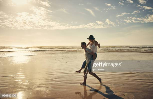 now for a little fun and a little sun - young couple stock pictures, royalty-free photos & images