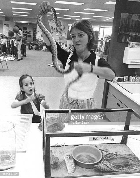 OCT 12 1972 OCT 25 1972 Now hand it over Lindy Moore waits in anticipations as Cindy Thompson takes bull snake from cage in Dry School class room