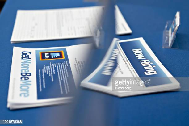 Job seekers fill out employment applications during a hiring event at an Aldi Supermarket in Darien Illinois US on Tuesday July 17 2018 Unemployment...