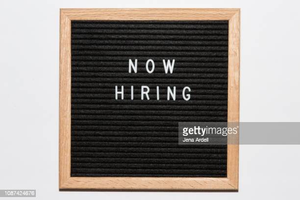 now hiring, now hiring sign, employment, work, career, help wanted sign, help wanted, letterboard, letter board - help wanted sign stock photos and pictures