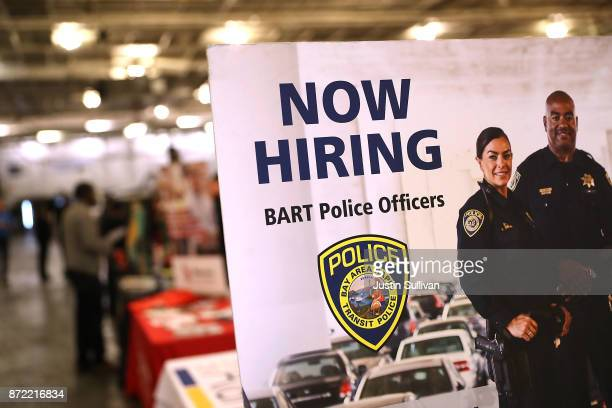 A now hiring sign for the Bay Area Rapid Transit police is displayed during a job fair for veterans at the USS Hornet Sea Air Space Museum on...
