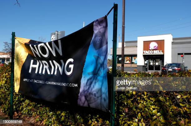 Now hiring sign in posted in front of a Taco Bell restaurant on February 05, 2021 in Novato, California. The U.S. Added 49,000 jobs in January,...