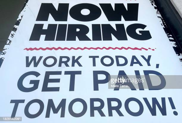 Now Hiring' sign is displayed at a fast food chain on June 23, 2021 in Los Angeles, California. Nearly 650,000 retail workers gave notice in April,...