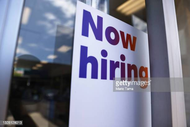 Now hiring' sign is displayed at a FedEx location on June 23, 2021 in Los Angeles, California. Nearly 650,000 retail workers gave notice in April,...