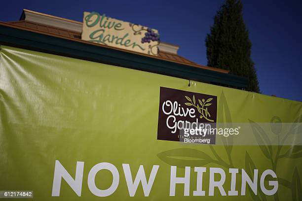 A Now Hiring sign is displayed outside a Darden Restaurants Inc Olive Garden location in Louisville Kentucky US on Tuesday Sept 27 2016 Darden...