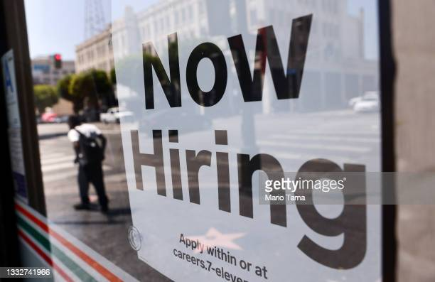 Now Hiring' sign is posted at a 7-Eleven store on August 06, 2021 in Los Angeles, California. The U.S. Economy added over 900,000 jobs in July, the...
