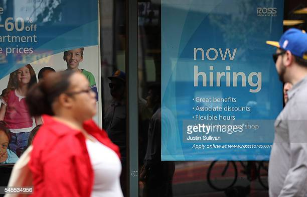 Now hiring' sign is posted outside of a Ross Dress for Less store on July 8, 2016 in San Francisco, California. According to the the U.S. Labor...