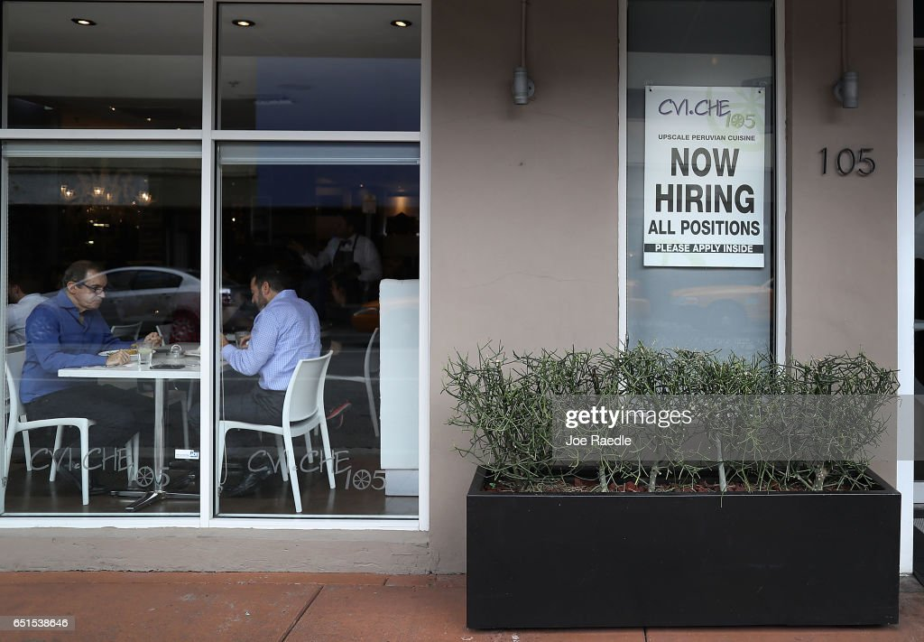 A now hiring sign is seen as the bureau of labor statistics