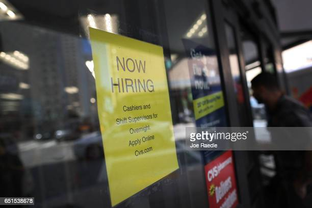 Now Hiring sign is seen as the Bureau of Labor Statistics reports that nonfarm payrolls increased by 235000 in February and the unemployment rate was...