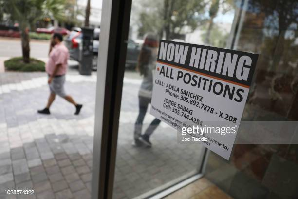 A 'now hiring' sign is seen in a restaurant window on September 7 2018 in Miami Florida The Labor Department reported that nonfarm payrolls grew by...