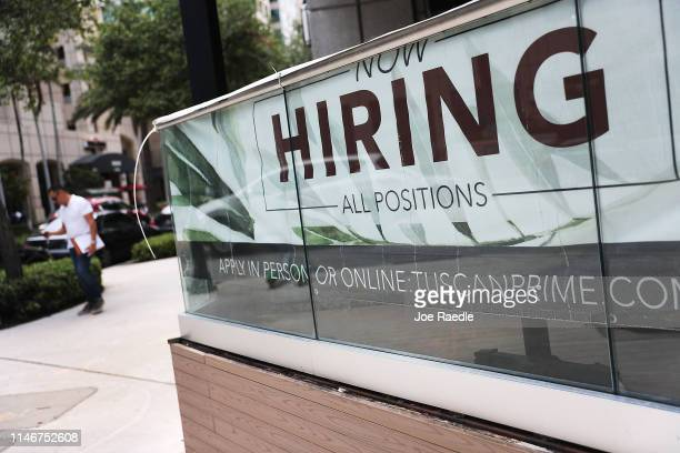 Now Hiring sign is seen on May 03 2019 in Fort Lauderdale Florida The Labor Department released the month of April hiring and unemployment data that...