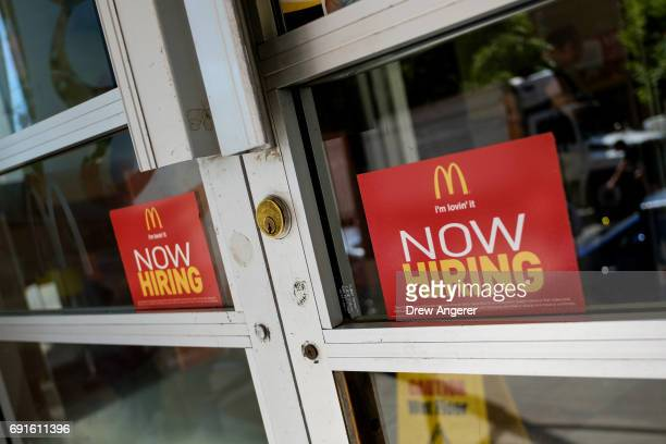 'Now Hiring' signage is displayed on the entrance to a McDonald's restaurant in Lower Manhattan June 2 2017 in New York City While US unemployment...