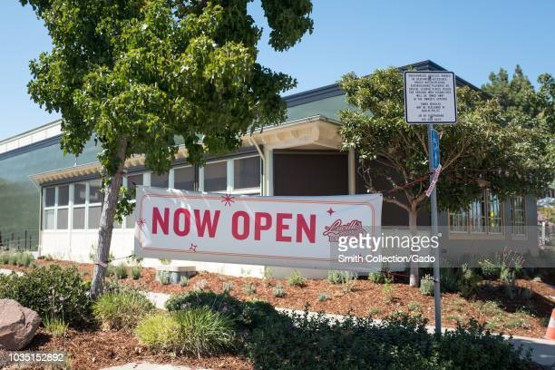 Now Open sign at entrance to Lucille's Barbecue restaurant in Dublin California announcing the restaurant's grand opening September 7 2018