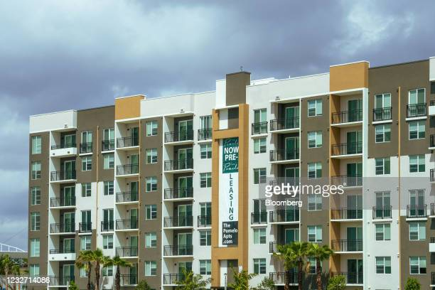 """Now Pre-Leasing"""" sign on an apartment building in the Miami Gardens neighborhood of Miami, Florida, U.S., on Monday, April 12, 2021. The U.S. Economy..."""