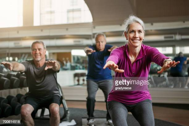now squat! - crouching stock pictures, royalty-free photos & images