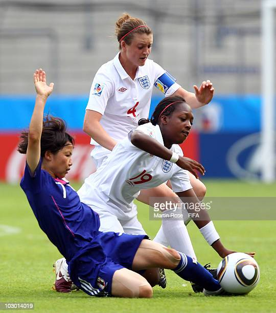 Nozomi Fujita of Japan and Danielle Carter of England compete for the ball during the 2010 FIFA Women's World Cup Group C match between Japan and...