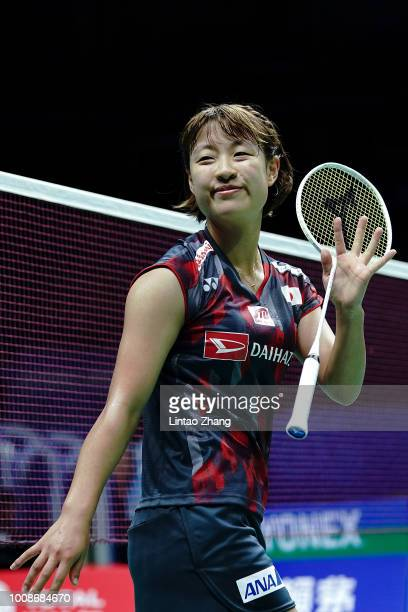 Nozomi Okuhara of Japan celebrates after defeating Rachel Honderich of Canada during their Women's singles match during the day three of Total BWF...