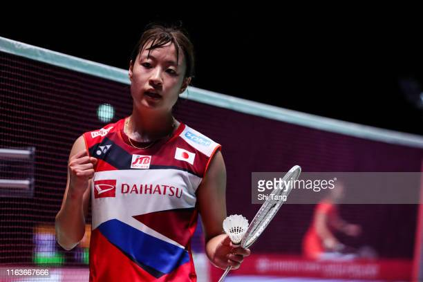 Nozomi Okuhara of Japan celebrates the victory in the Women's Singles first round match against Saena Kawakami of Japan during day one of the...