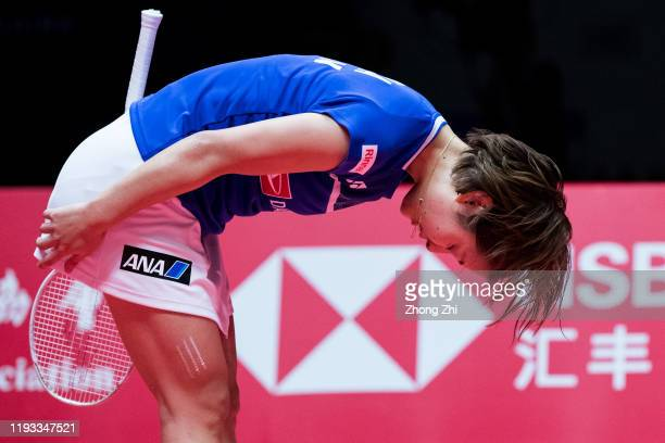 Nozomi Okuhara of Japan celebrates winning over the match against Tai Tzu Ying of Chinese Taipei on day 1 of the HSBC BWF World Tour Finals 2019 at...