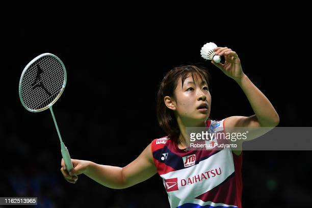 Nozomi Okuhara of Japan competes against Deng Joy Xuan of Hong Kong on day two of the Bli Bli Indonesia Open at Istora Gelora Bung Karno on July 17...