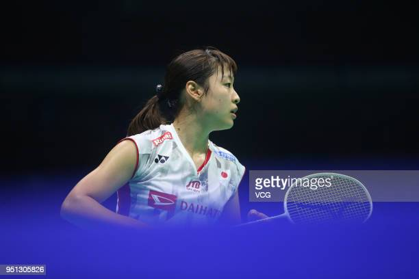 Nozomi Okuhara of Japan competes against Gao Fangjie of China during women's singles first round match on day two of 2018 Badminton Asia...