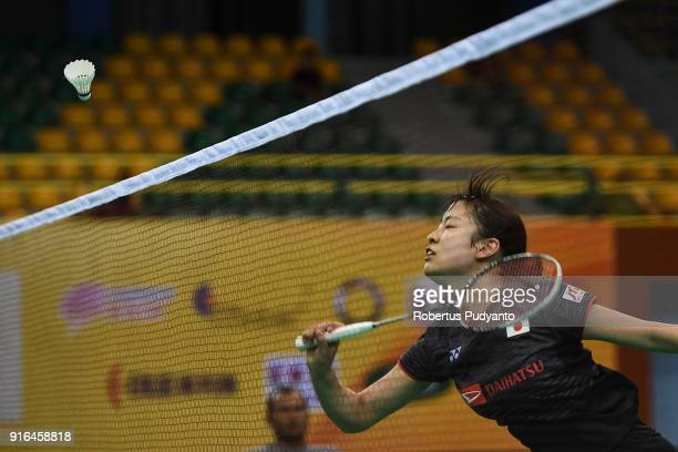 Nozomi Okuhara of Japan competes against Gregoria Mariska Tunjung of Indonesia during Women's Team Semifinal match between Japan and Indonesia in the...