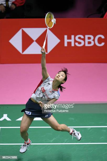 Nozomi Okuhara of Japan competes against Lee Jang Mi of Korea during the Semifinals match on day six of the BWF Thomas Uber Cup at Impact Arena on...