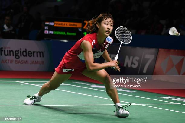 Nozomi Okuhara of Japan competes against Pusarla V Sindhu of India on day four of the Bli Bli Indonesia Open at Istora Gelora Bung Karno on July 19...
