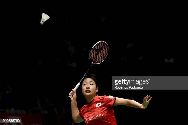 Nozomi Okuhara of Japan competes against Ratchanok Intanon of Thailand during the Women's Singles Quarter Final match of the Daihatsu Indonesia...