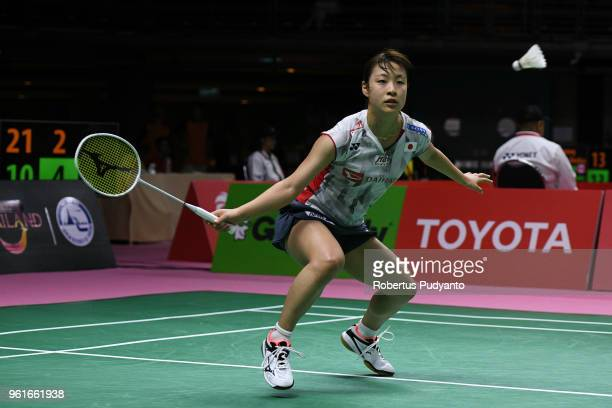Nozomi Okuhara of Japan competes against Vaishnavi Reddy Jakka of India during Preliminary Round on day four of the BWF Thomas Uber Cup at Impact...