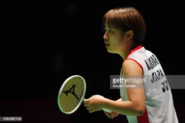 Nozomi Okuhara of Japan competes in the women's singles final match against Carolina Marin of Spain on day six of the Yonex Japan Open at Musashino...