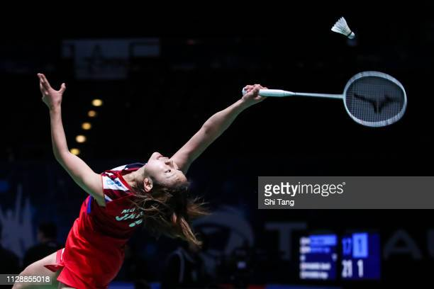 Nozomi Okuhara of Japan competes in the Women's Singles first round match against Gregoria Mariska Tunjung of Indonesia on day one of the Yonex All...