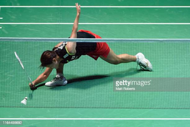 Nozomi Okuhara of Japan competes in the Women's Singles semifinal match against Michelle Li of Canada on day five of the Daihatsu Yonex Japan Open...