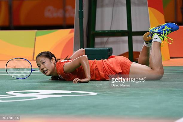 Nozomi Okuhara of Japan falls over after playing a shot during the Women's Badminton Singles Semifinal against Pusarla V Sindhu of India on Day 13 of...