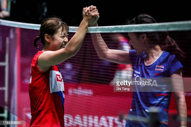 Nozomi Okuhara of Japan greets Nitchaon Jindapol of Thailand after their Women's Singles quarter finals match during day four of the Daihatsu Yonex...