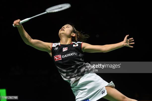Nozomi Okuhara of Japan hits a return against Chen Yufei of China during their women's singles final match at the Fuzhou China Open badminton...