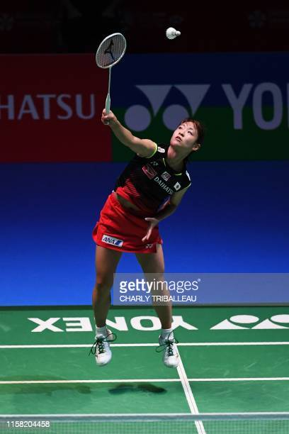 Nozomi Okuhara of Japan hits a return during his women's singles final match against Akane Yamaguchi of Japan at the Japan Open badminton tournament,...