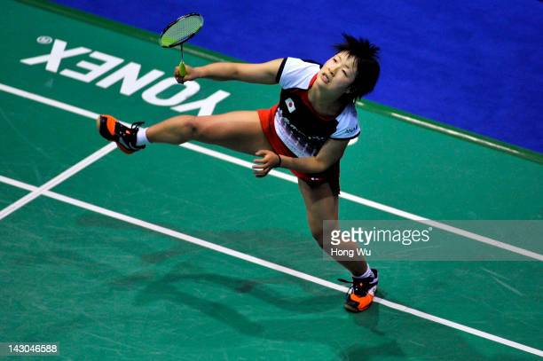Nozomi Okuhara of Japan plays a shot during her match against Han Li of China during day Two of the 2012 Badminton Asia Championships at Qingdao...