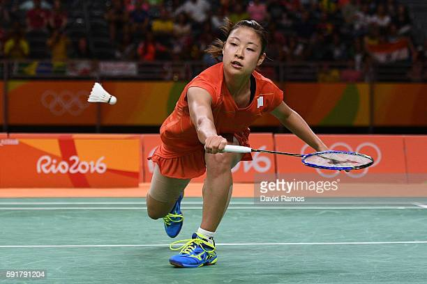 Nozomi Okuhara of Japan plays a shot during the Women's Badminton Singles Semi-final against Pusarla V Sindhu of India on Day 13 of the Rio 2016...