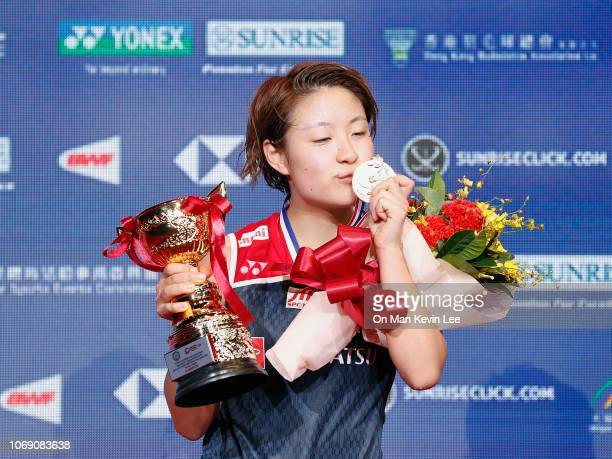 Nozomi Okuhara of Japan poses with her trophy after winning the final of Women's Single of Yonex Sunrise Hong Kong Open 2018 on Day 6 at Hong Kong...