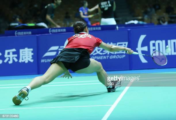 Nozomi Okuhara of Japan returns to Lee Jangmi of South Korea during 2017 Badminton Asia Championships women's singles first round match at Wuhan...