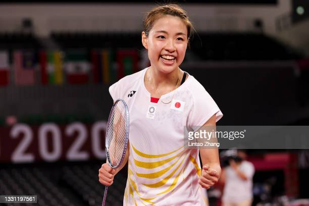 Nozomi Okuhara of Team Japan celebrates after her victory against Michelle Li of Team Canada during a Women's Singles Round of 16 match on day six of...