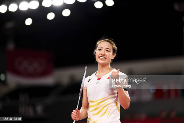 Nozomi Okuhara of Team Japan celebrates after her victory against Evgeniya Kosetskaya of Team ROC during a Women's Singles Group E match on day five...