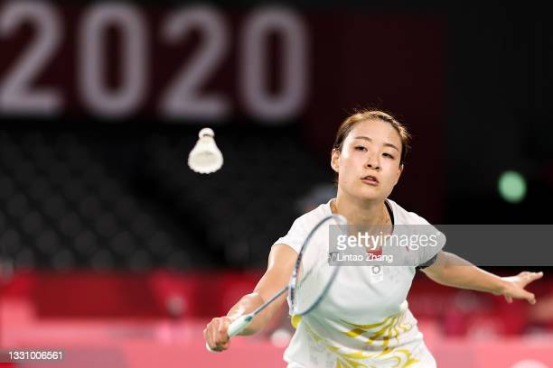 Nozomi Okuhara of Team Japan competes against Evgeniya Kosetskaya of Team ROC during a Women's Singles Group E match on day five of the Tokyo 2020...