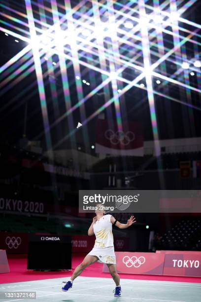 Nozomi Okuhara of Team Japan competes against He Bing Jiao of Team China during a Women's Singles Quarterfinal match on day seven of the Tokyo 2020...