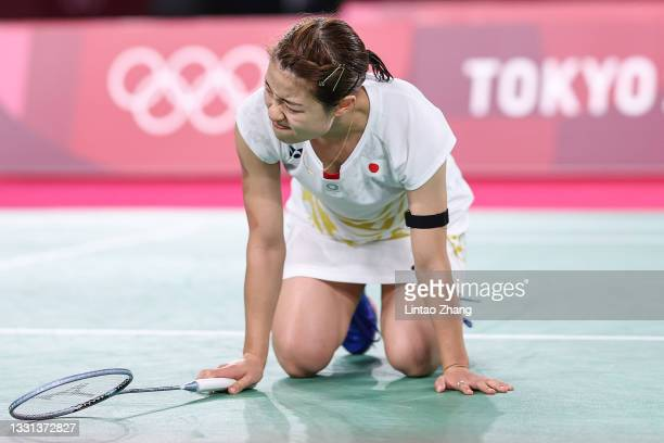 Nozomi Okuhara of Team Japan looks dejected after being defeated by He Bing Jiao of Team China during a Women's Singles Quarterfinal match on day...