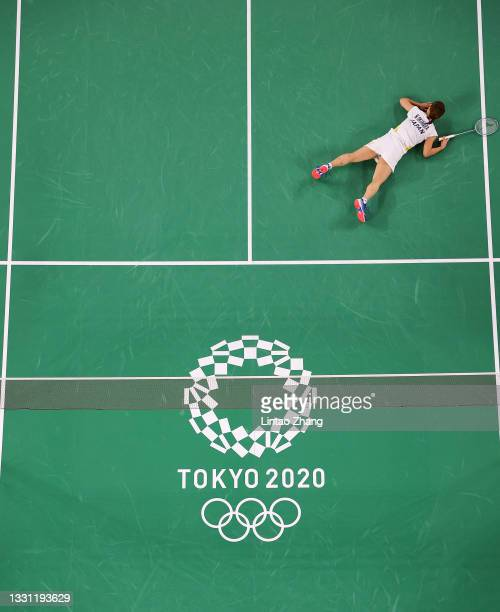 Nozomi Okuhara of Team Japan reacts as she competes against Michelle Li of Team Canada during a Women's Singles Round of 16 match on day six of the...
